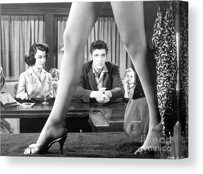 Singer Canvas Print featuring the photograph Elvis Presley Framed Between Womans Legs by Bettmann