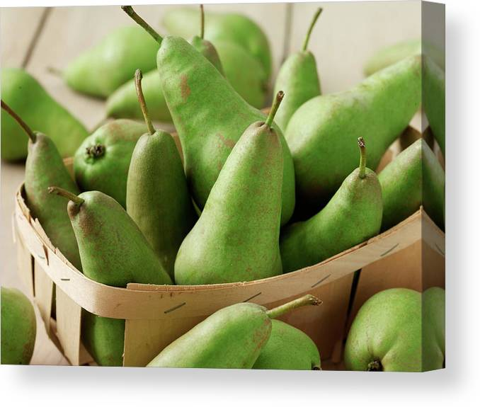 Fruit Carton Canvas Print featuring the photograph Green Pears In Punnet And Wooden Table by Chris Ted