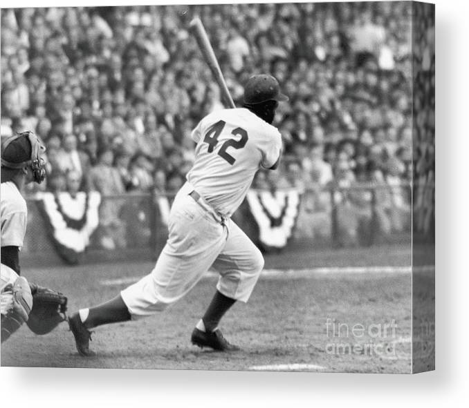 Sports Helmet Canvas Print featuring the photograph Jackie Robinson At Bat by Robert Riger