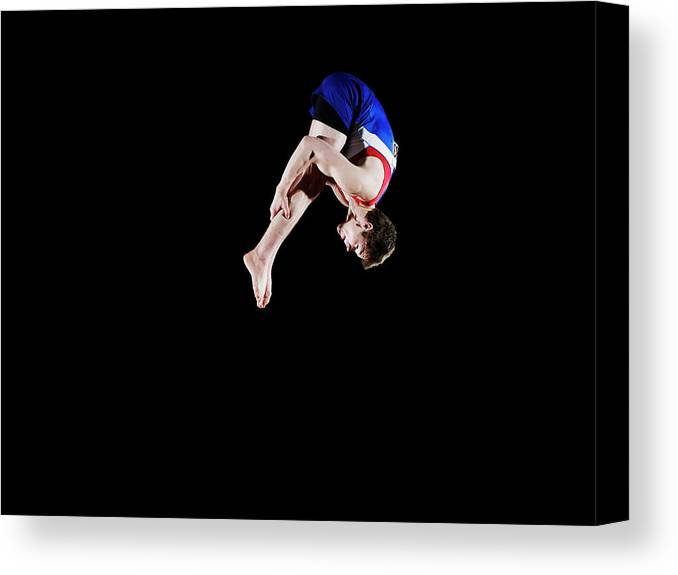 Focus Canvas Print featuring the photograph Male Gymnast 16-17 Mid Air, Black by Thomas Barwick