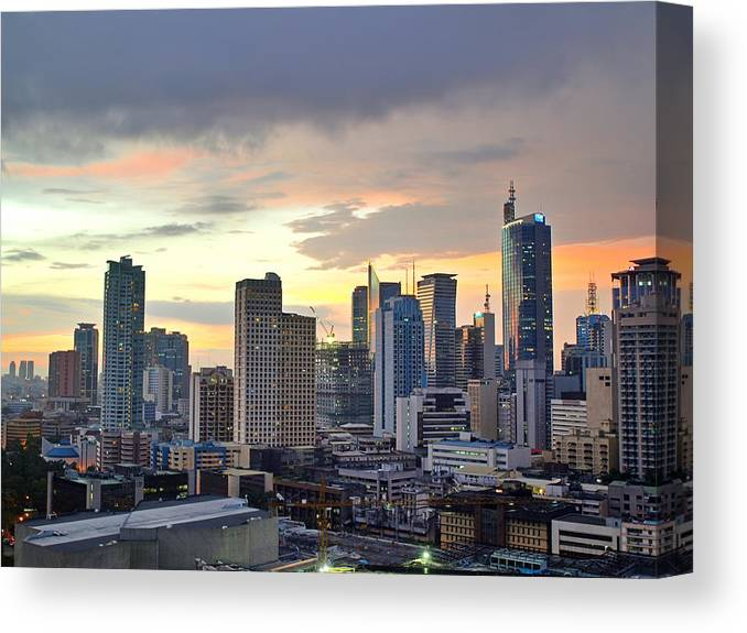 Outdoors Canvas Print featuring the photograph Sunset Over Makati City, Manila by Neil Howard