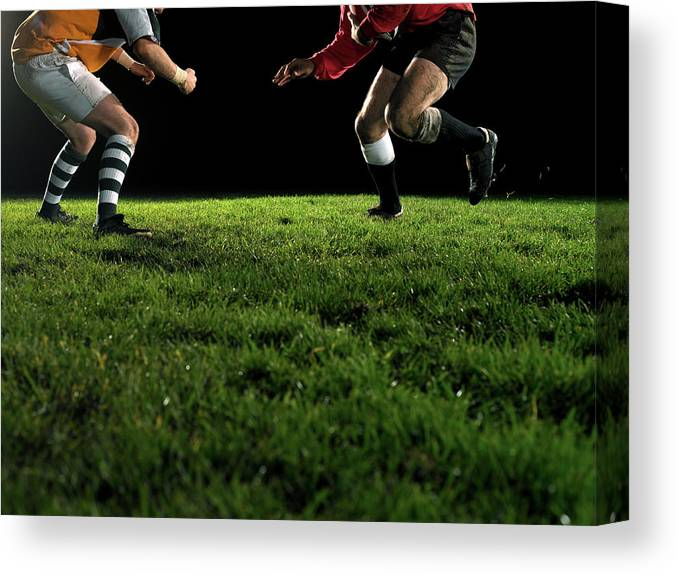 Grass Canvas Print featuring the photograph Two Opposing Rugby Players, One Holding by Thomas Barwick