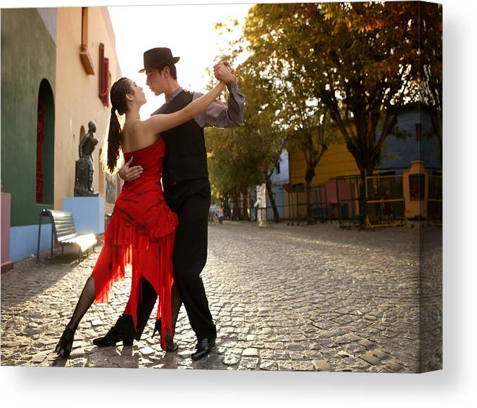 Young Men Canvas Print featuring the photograph Young Couple Dancing Tango In Street by Buena Vista Images