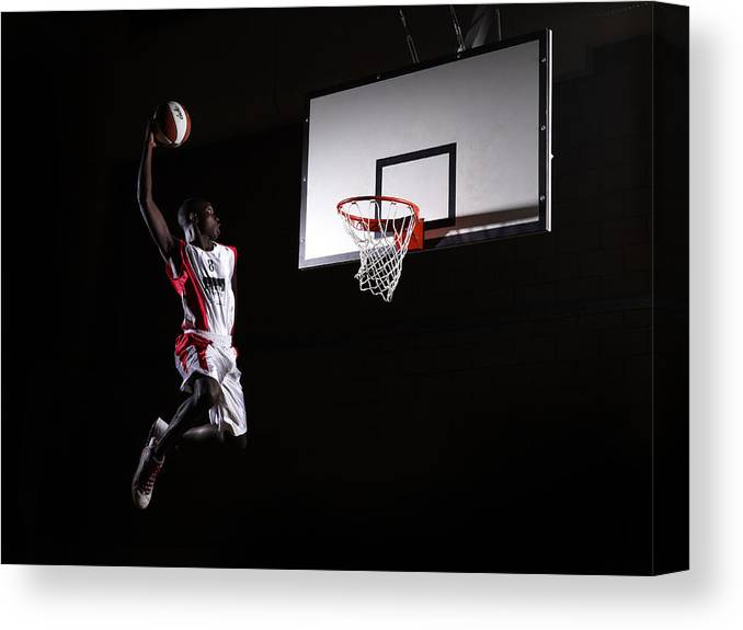 Human Arm Canvas Print featuring the photograph Young Man In The Air About To Dunk The by Compassionate Eye Foundation/steve Coleman/ojo Images Ltd