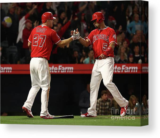 People Canvas Print featuring the photograph Albert Pujols, Andrelton Simmons, and Mike Trout by Victor Decolongon