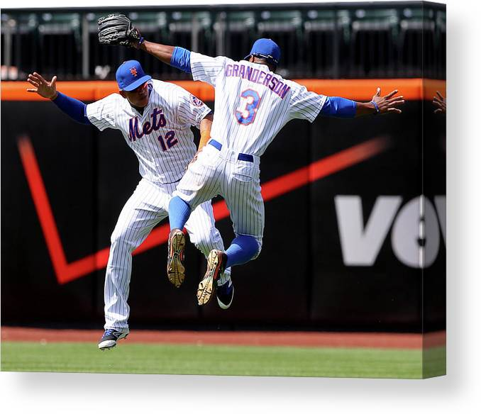 People Canvas Print featuring the photograph Juan Lagares and Curtis Granderson by Elsa