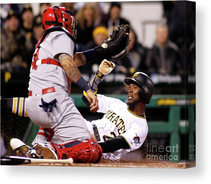 People Canvas Print featuring the photograph Yadier Molina And Andrew Mccutchen by Justin K. Aller