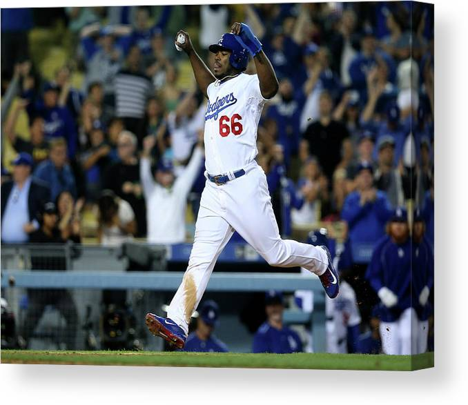 Ninth Inning Canvas Print featuring the photograph Yasiel Puig and Howie Kendrick by Stephen Dunn