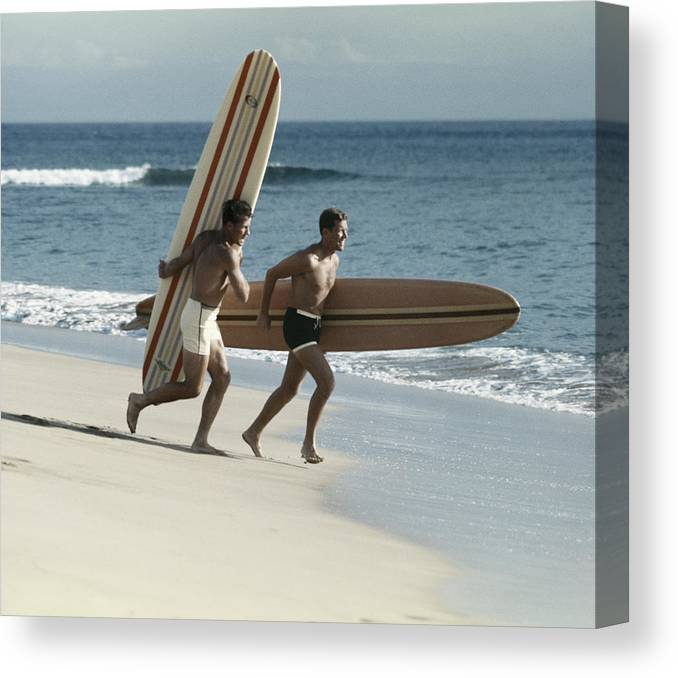 People Canvas Print featuring the photograph Young Men Running On Beach With by Tom Kelley Archive