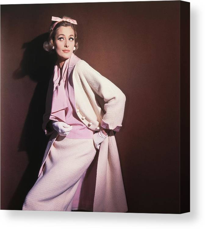 Studio Shot Canvas Print featuring the photograph Model Wearing White Coat Over Pink Blouse by Horst P. Horst