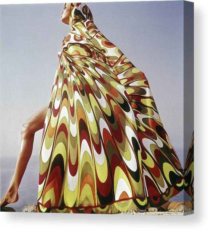 Exterior Canvas Print featuring the photograph A Model Posing In A Colorful Cover-up by Henry Clarke