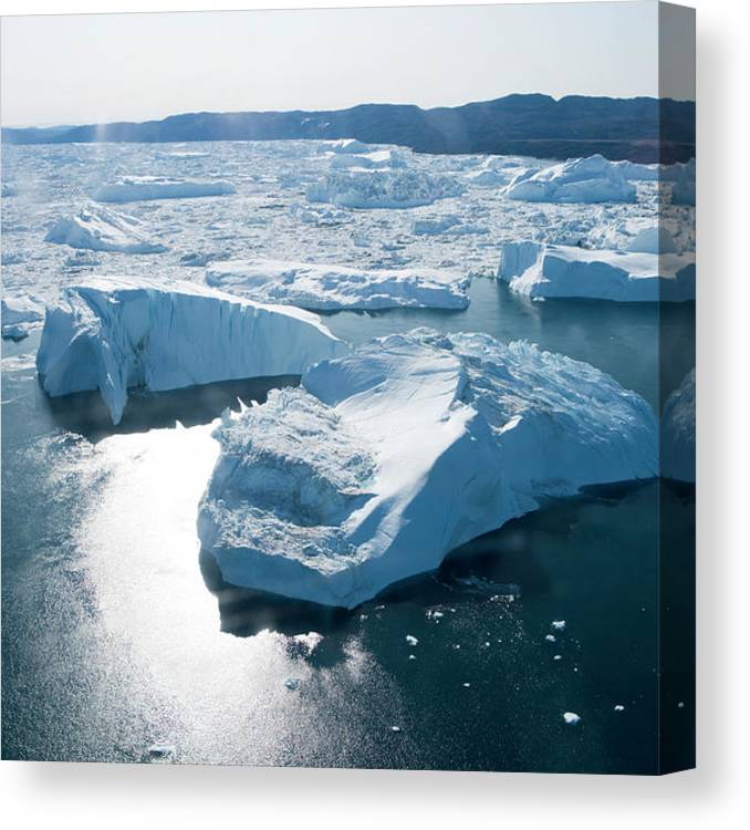 Melting Canvas Print featuring the photograph Aerial Of Icebergs Of Ilulissat by Holger Leue
