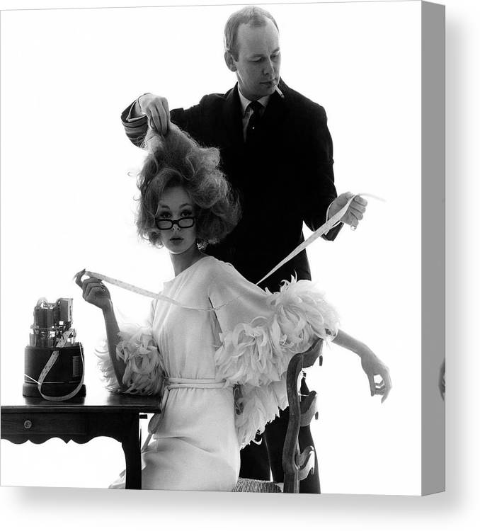 Beauty Canvas Print featuring the photograph Hairstylist Kenneth Holding The Hair Of A Model by Bert Stern