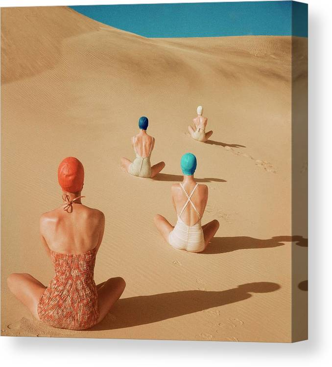 Fashion Canvas Print featuring the photograph Models Sitting On Sand Dunes by Clifford Coffin
