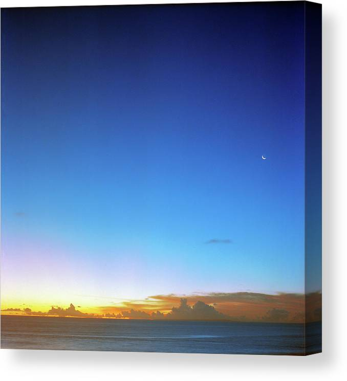 Tranquility Canvas Print featuring the photograph Sunset And Moon At Uluwatu by Vsevolod Vlasenko