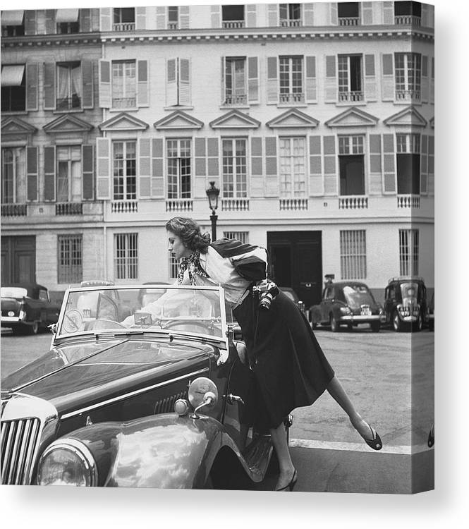 Personality Canvas Print featuring the photograph Suzy Parker Outside The French Vogue Office by Jacques Boucher