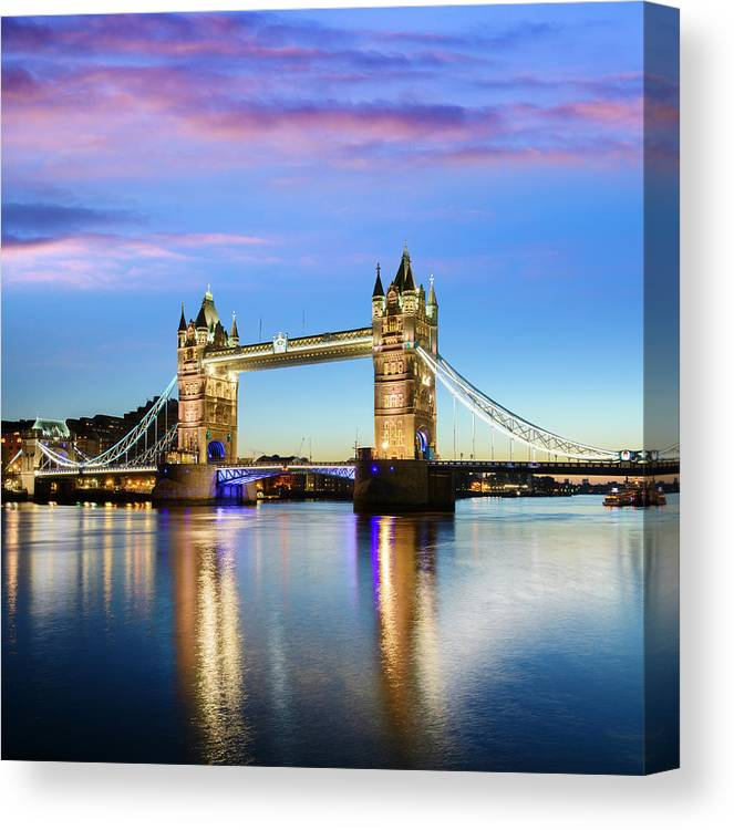 Downtown District Canvas Print featuring the photograph Tower Bridge Located In London by Deejpilot