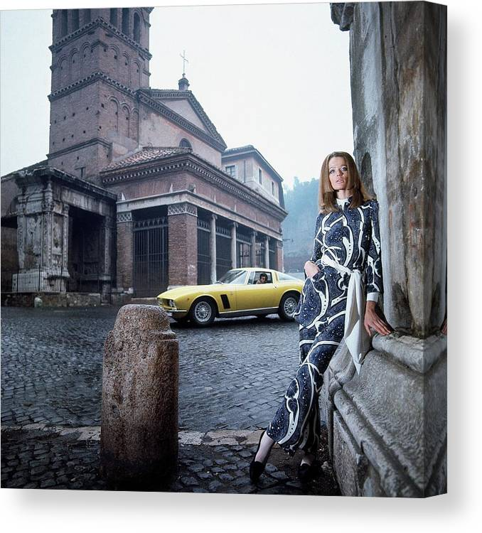 Fashion Canvas Print featuring the photograph Veruschka Von Lehndorff Standing In Piazza Di San by Franco Rubartelli