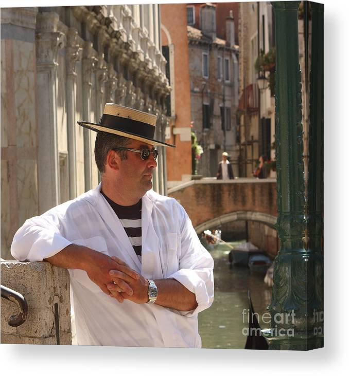 Gondolier Canvas Print featuring the photograph Gondolier in Venice waiting for a Fare by Michael Henderson