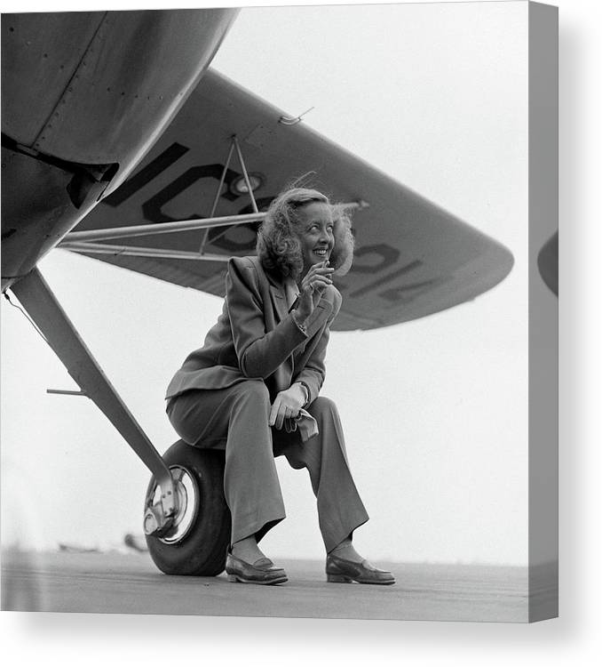 Timeincown Canvas Print featuring the photograph Bette Davis With Airplane, 1947 by Loomis Dean