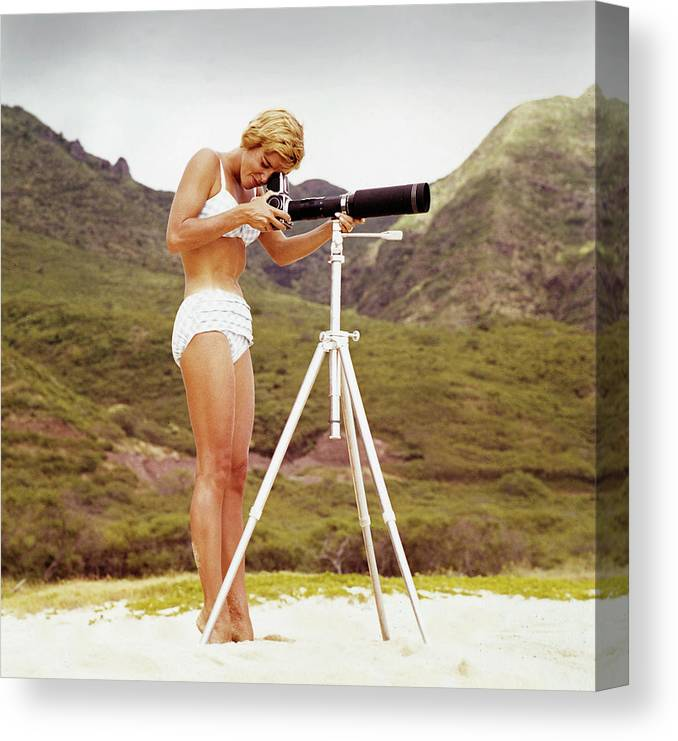 People Canvas Print featuring the photograph Bikini Girl And Camera by Tom Kelley Archive