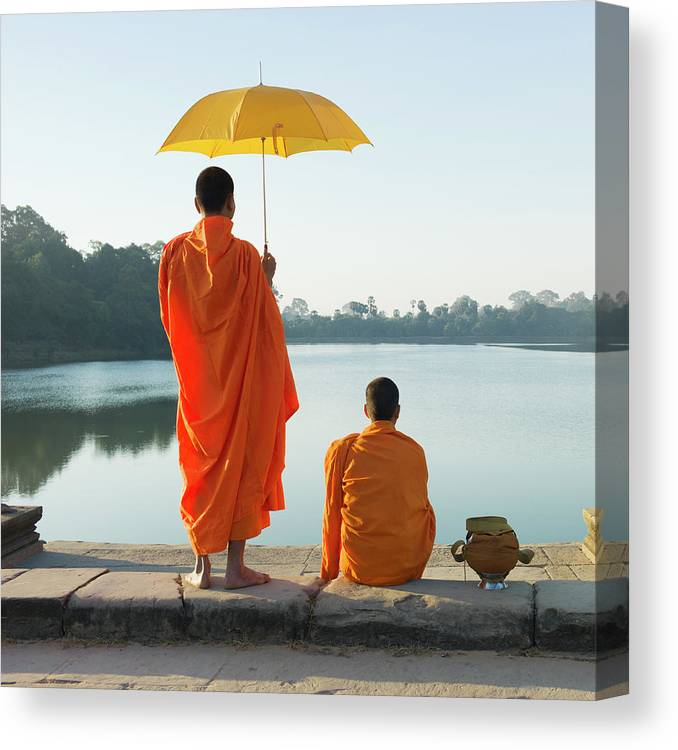 Young Men Canvas Print featuring the photograph Buddhist Monks Standing In Front Of by Martin Puddy
