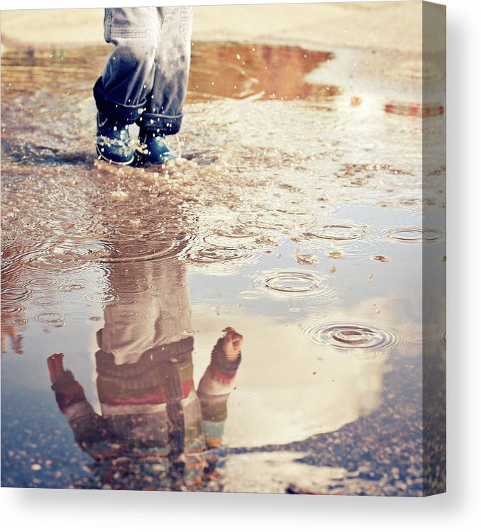 Toddler Canvas Print featuring the photograph Child In A Puddle by Vpopovic