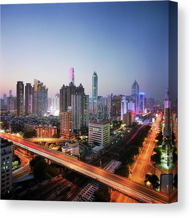 Corporate Business Canvas Print featuring the photograph China, Shenzen Skyline At Dusk by Martin Puddy
