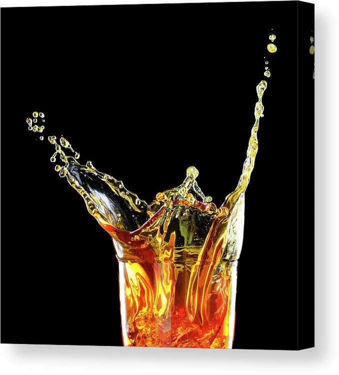 Alcohol Canvas Print featuring the photograph Cocktail With Big Splash In A Tumbler by Chris Stein
