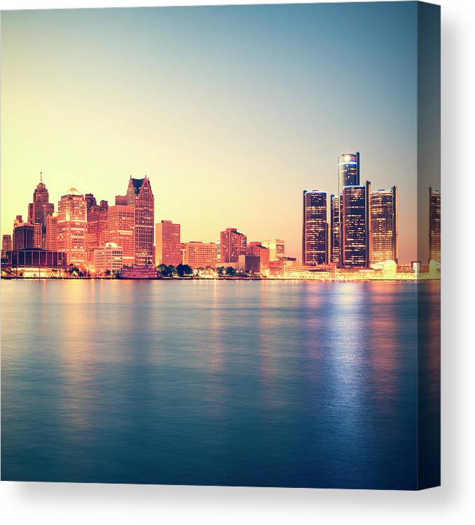 Downtown District Canvas Print featuring the photograph Detroit At Sunset by Espiegle