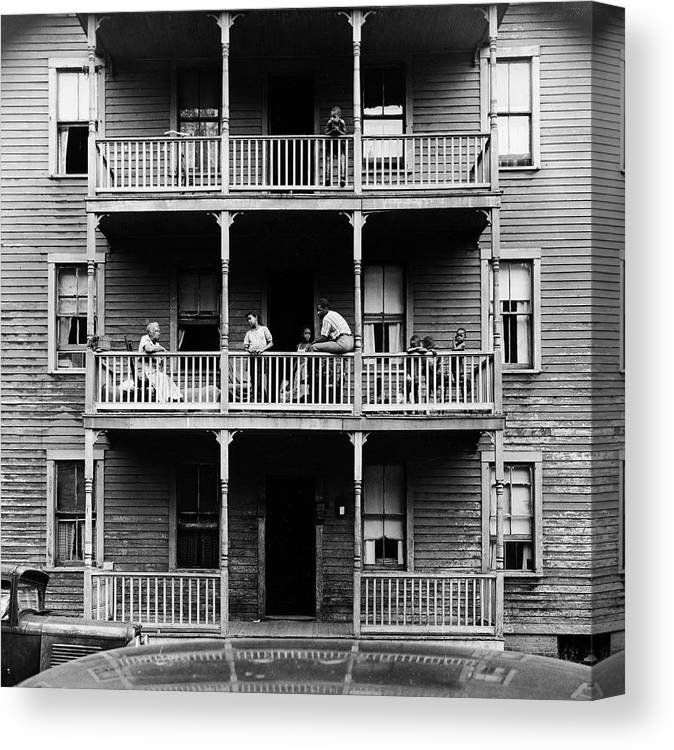Timeincown Canvas Print featuring the photograph Family On Balcony Of Apartment Building by Gordon Parks
