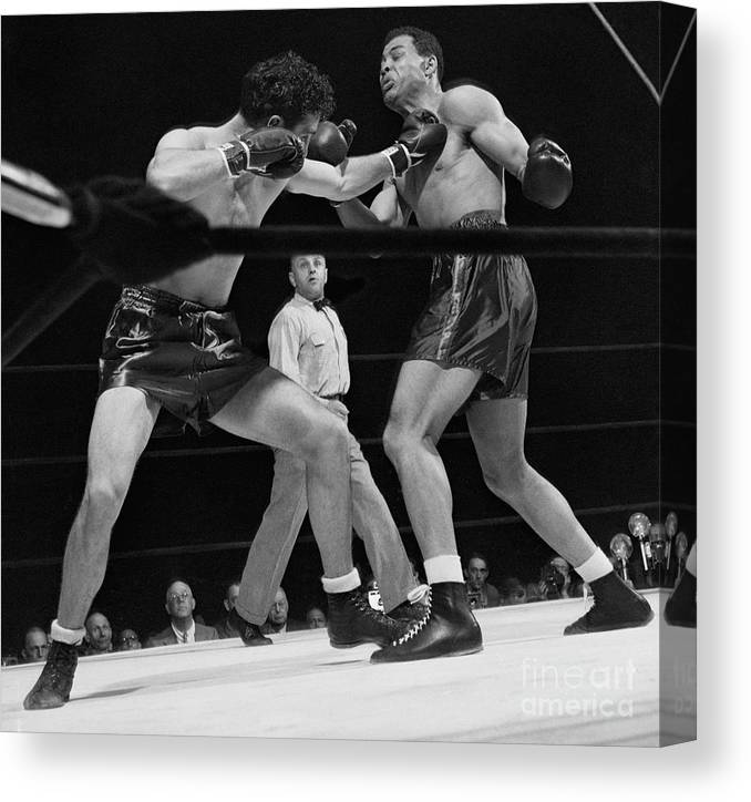 Mature Adult Canvas Print featuring the photograph Joe Louis And Billy Conn In Boxing Match by Bettmann
