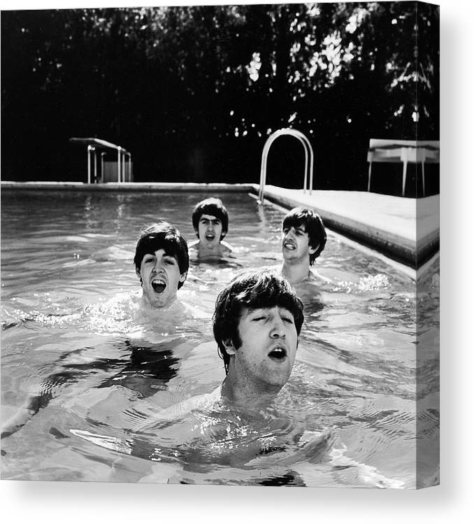 Singer Canvas Print featuring the photograph L-r Paul Mccartney, George Harrison by John Loengard