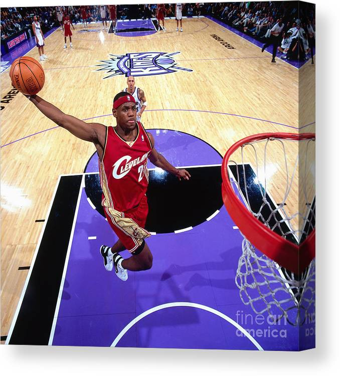 Nba Pro Basketball Canvas Print featuring the photograph Lebron James Goes For A Dunk by Rocky Widner