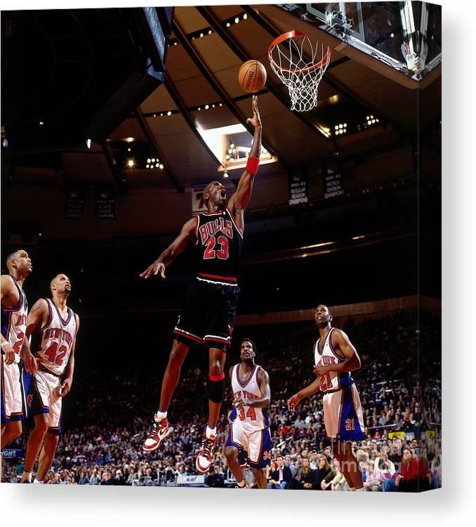Chicago Bulls Canvas Print featuring the photograph Michael Jordan Action Portrait by Nathaniel S. Butler