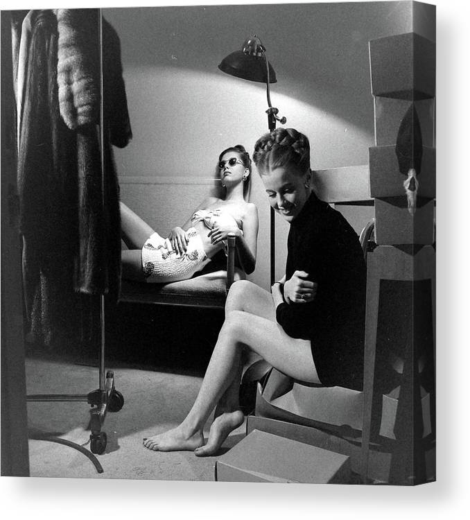 Built Structure Canvas Print featuring the photograph Models At The Neiman Marcus Store, An by Nina Leen