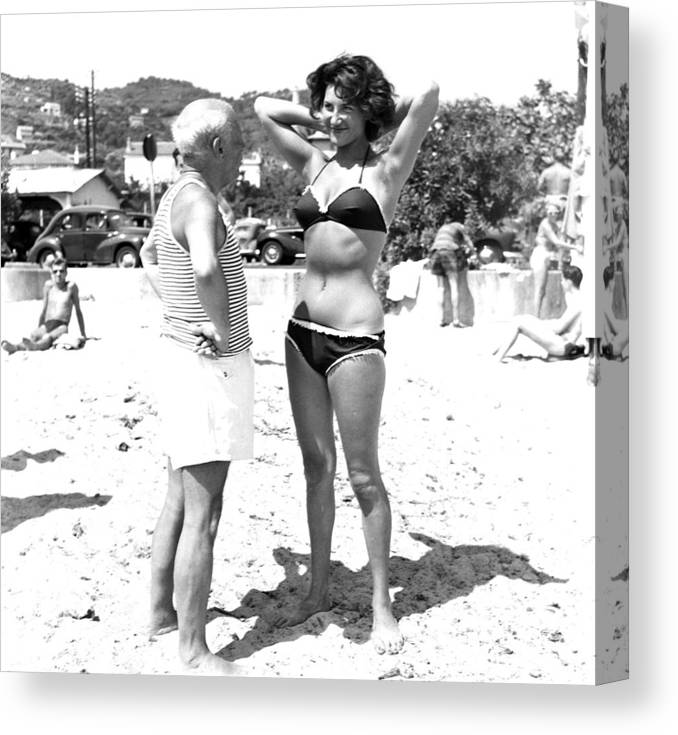 Artist Canvas Print featuring the photograph Picasso And Bikini-clad Woman On The by Hulton Archive