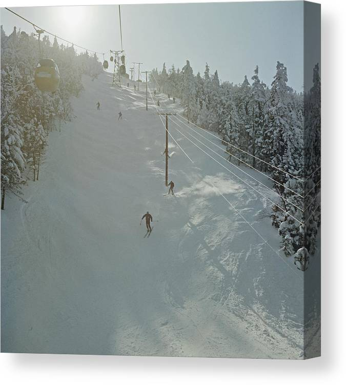 Skiing Canvas Print featuring the photograph Skiing In Sugarbush by Slim Aarons