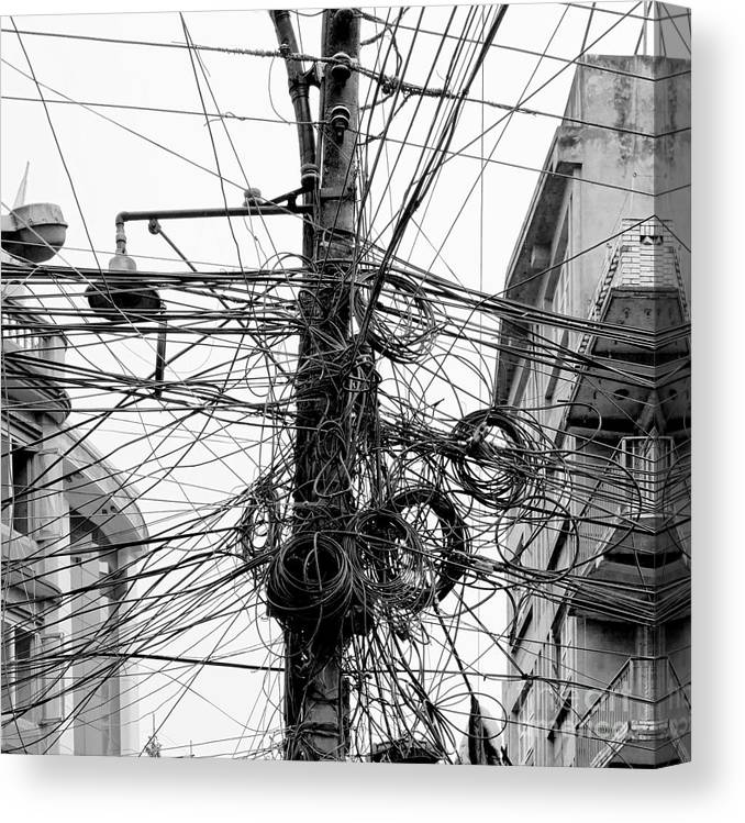 Capital Canvas Print featuring the photograph The Chaos Of Cables And Wires In by Vadim Petrakov