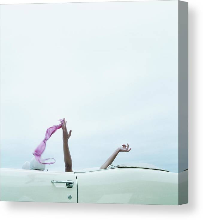 Young Men Canvas Print featuring the photograph Young Woman In Convertible Car, Arms by Jerome Tisne