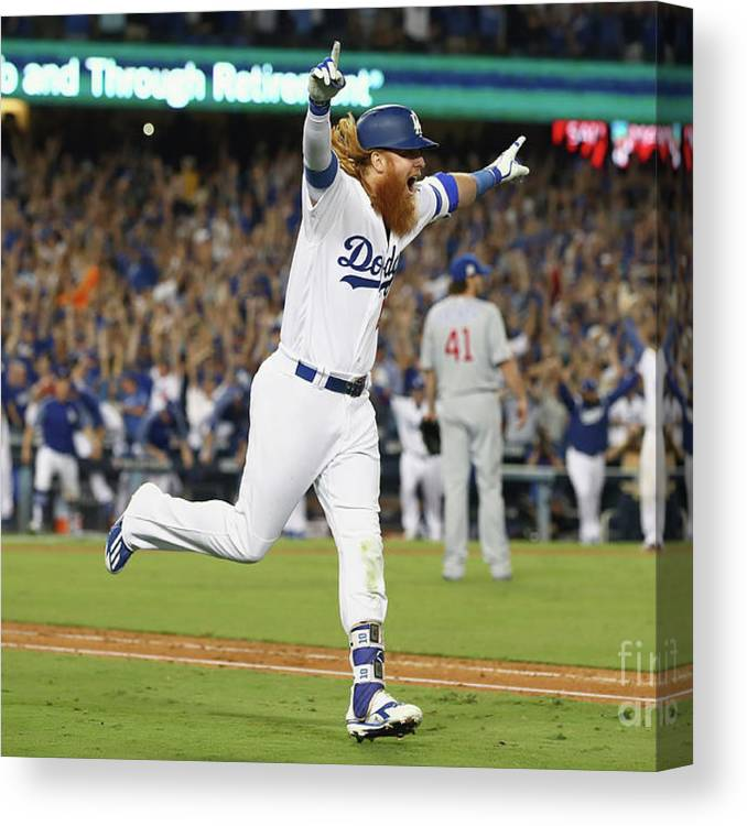 Game Two Canvas Print featuring the photograph Justin Turner by Ezra Shaw