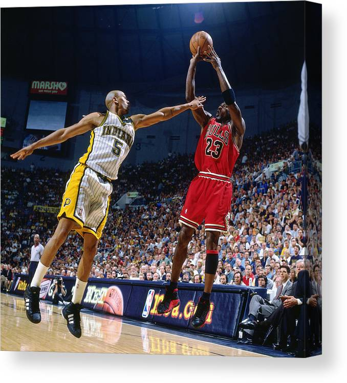 Chicago Bulls Canvas Print featuring the photograph Jalen Rose and Michael Jordan by Nathaniel S. Butler