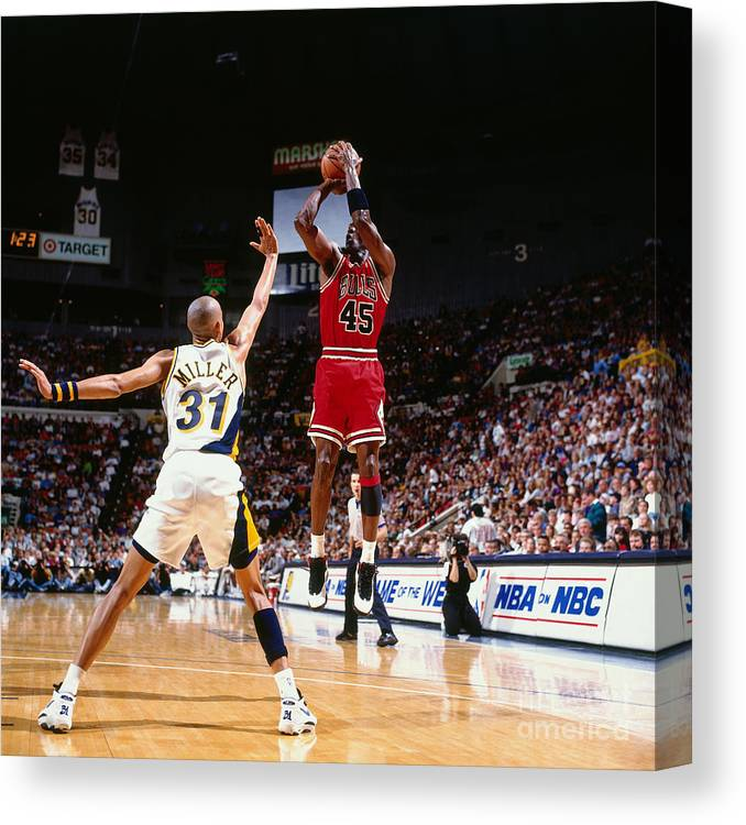 Nba Pro Basketball Canvas Print featuring the photograph Reggie Miller and Michael Jordan by Nathaniel S. Butler