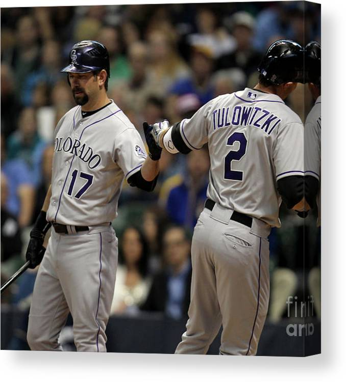 People Canvas Print featuring the photograph Todd Helton and Troy Tulowitzki by Mike Mcginnis