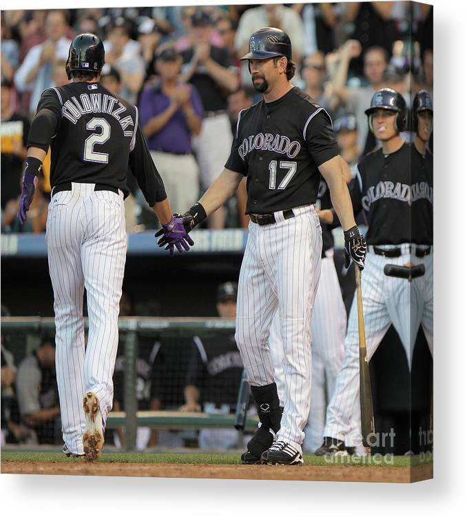 People Canvas Print featuring the photograph Todd Helton, Troy Tulowitzki, and Anibal Sanchez by Doug Pensinger