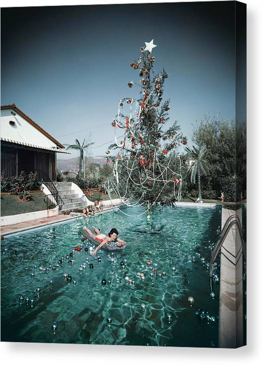 People Canvas Print featuring the photograph Christmas Swim by Slim Aarons
