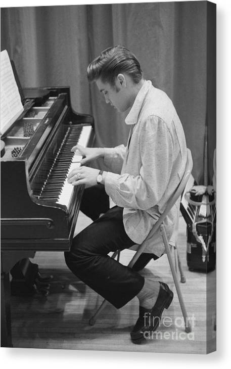 Elvis Presley Canvas Print featuring the photograph Elvis Presley on piano while waiting for a show to start 1956 by The Harrington Collection