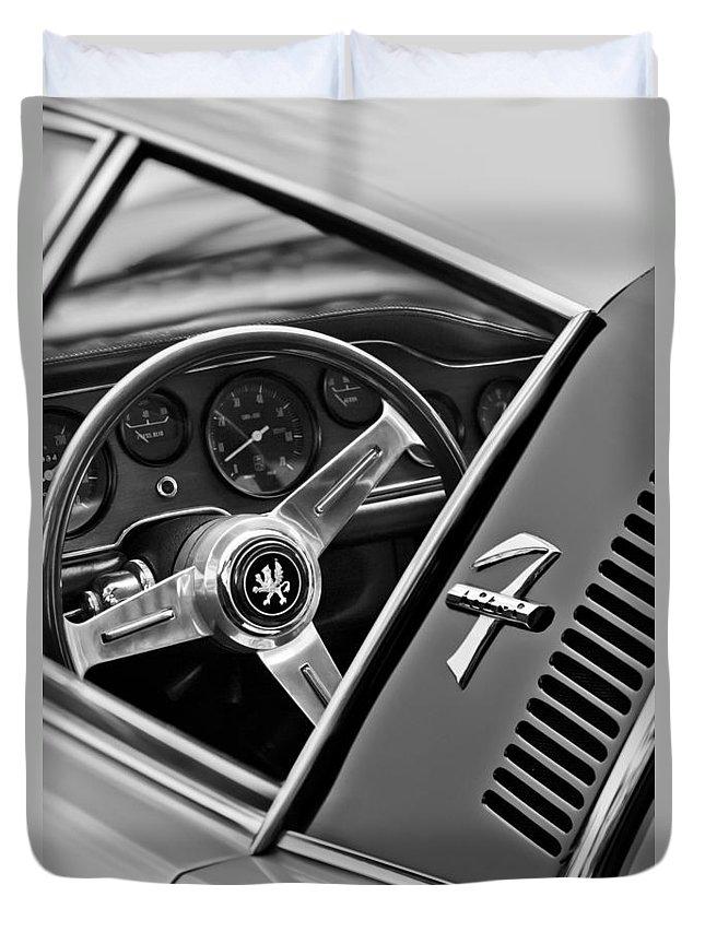 1971 Iso Grifo Can Am Steering Wheel Emblem Duvet Cover featuring the photograph 1971 Iso Grifo Can Am Steering Wheel Emblem by Jill Reger