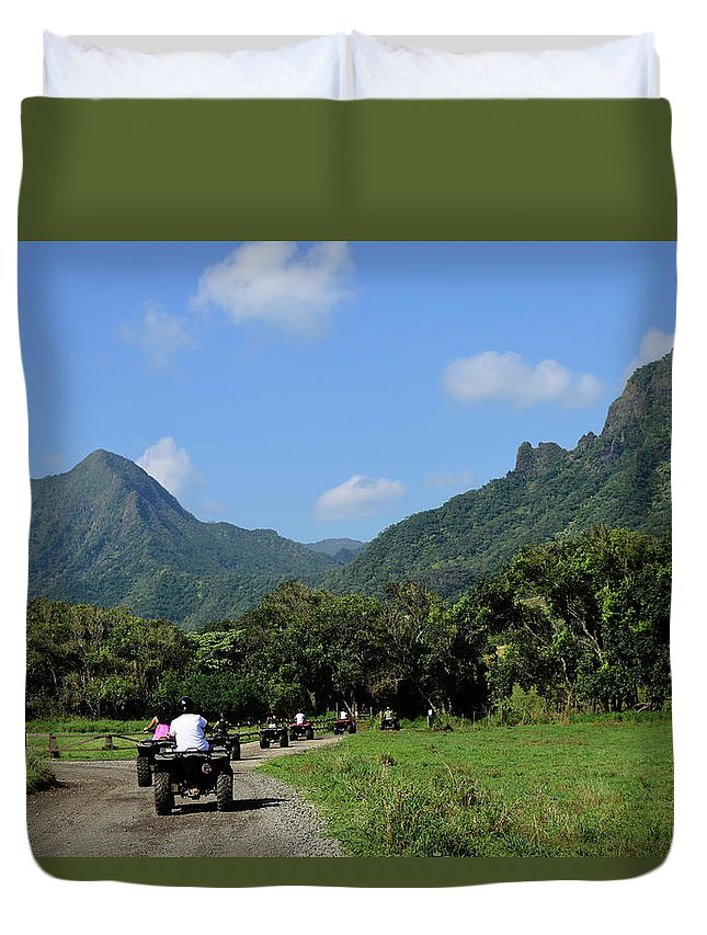 Horizontal Duvet Cover featuring the photograph A Group Of Atv Quad Riders Take by Stocktrek Images