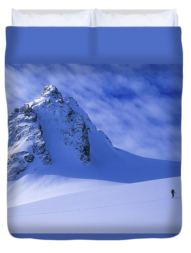 Adventure Duvet Cover featuring the photograph A Woman Ski Tours And Explores by Jimmy Chin